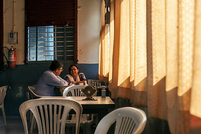 A couple sit and talk Customers in the Indian Coffee House in Nagpur.