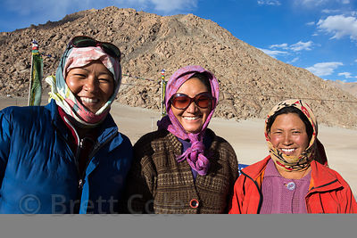 Three ladies from the Himalayan village of Umla wait for a bus home after finishing a shift at an Indian Army construction si...