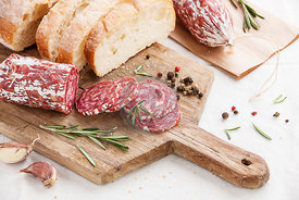 Italian salami with bread on wooden cutting Board