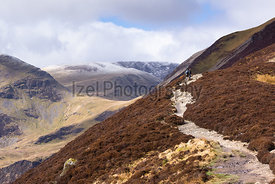 Hikers Walking towards Grisedale Pike in the Lake District