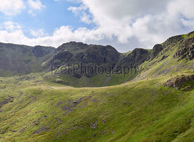 Summit of High Stile and Chapel Crags from the path leading to the summit of Red Pike in the English Lake District, UK.
