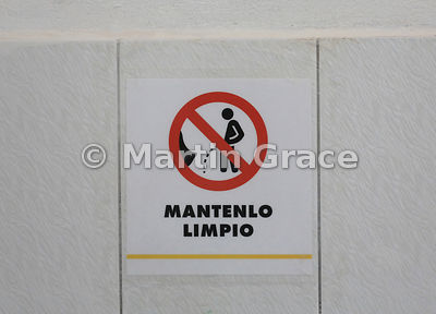 Sign encouraging men to 'Keep It Clean' in toilets, Puerto Ayora, Galapagos. It's a good thing the red diagonal is in just th...