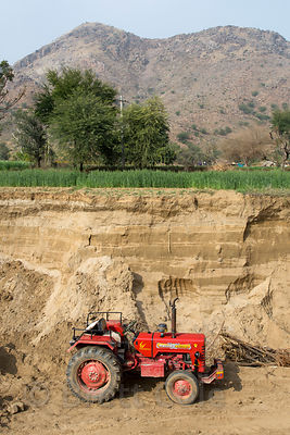 Tractor next to an excavation show the very deepy sandy soil of the Thar Desert, near Amba village, Rajasthan, India