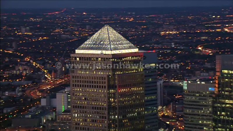 Aerial footage over Canary Wharf at night, Isle of Dogs, London, England, UK