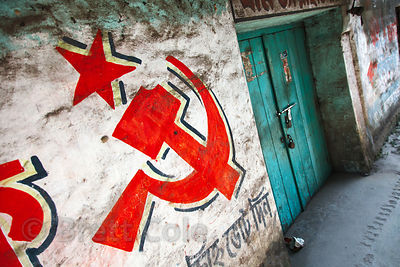 Communist party logo painted on a wall near Metiabruz, Kolkata, India.