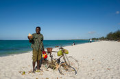 Man selling coconuts on the beach, Dar es Salaam, Tanzania