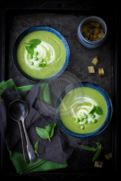 Pea soup served on a dark tray