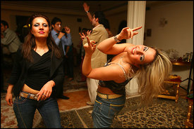 Men and Women at a party in a home in an affluent section of northern Tehran wear western clothing and dance to western music...