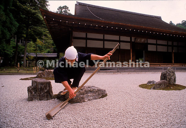 Perched on a rock at Kyoto's Ryoan-ji, a Buddhist monk is intent upon meticulously raking the fine gravel sea that swirls aro...