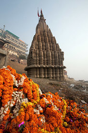Floral garlands in front of the sinking Shiva Temple, Manikarnika Ghat, Varanasi, India.
