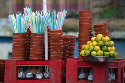 Nice variety of forms typical to India in a fruit juice sellers stand, Hatkhola, Kolkata, India