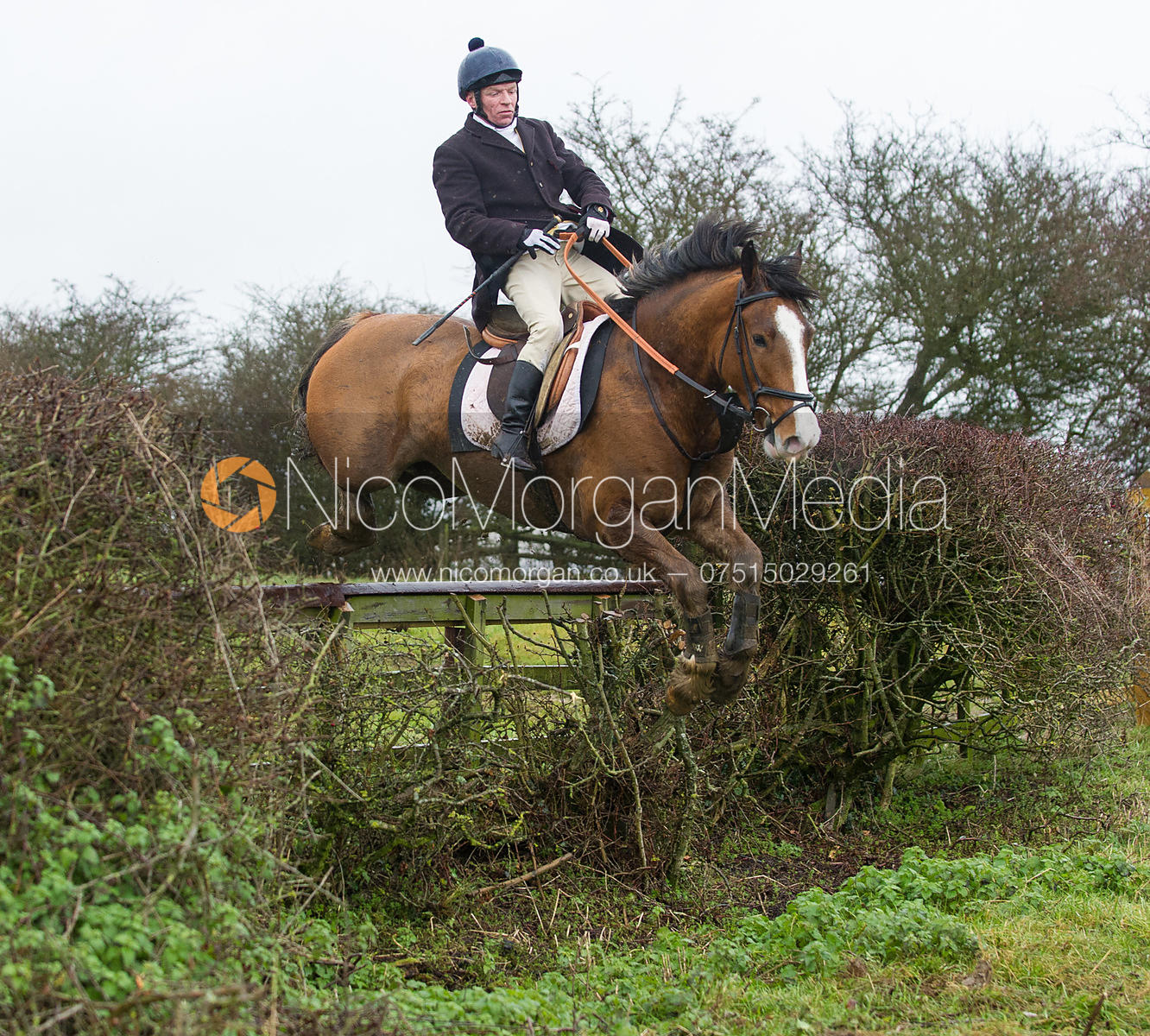Jimmy Quinn jumping near the new Jubilee Covert - Cottesmore Hunt at Deane Bank Farm 4/12/12