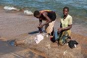 women washing clothes in lake Niassa, Mozambique