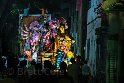 Idols of the goddess Durga are paraded through the streets during the Durga Puja festival, Bhawanipur, Kolkata, India