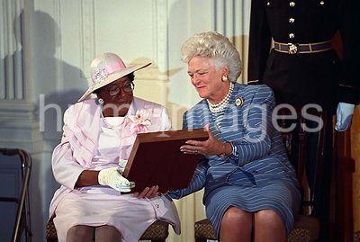 Mrs. Barbara Bush passing the case with the Medal of Honor to Mrs. Georgina Palmer, from Richmond, California (88 years).  Th...
