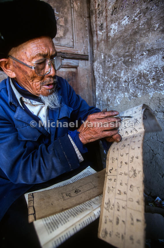 He Zouyi, 82, translates Naxi pictographs. He and National Geographic explorer, Joseph Rock produced Naxi/English dictionary....