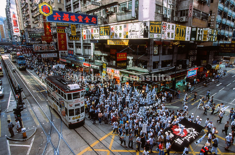 Exercising their rights of free assembly and free speech, marchers file through Hong Kong to mark the anniversary  of the 198...