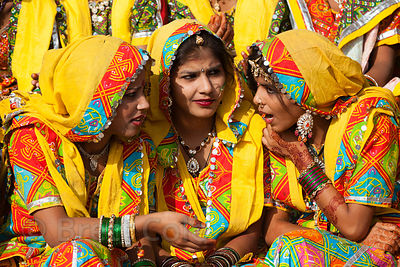 Girls in brightly colored costumes dance during the opening of the 2013 Pushkar Camel Mela, Pushkar, Rajasthan, India.