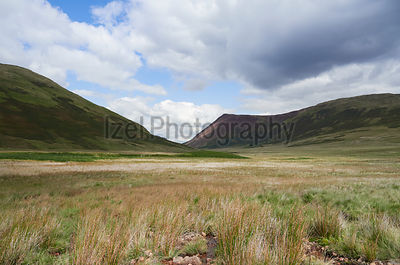 The marshland of Mosedale Beck below Mellbreak near Buttermere in the English Lake District, UK.