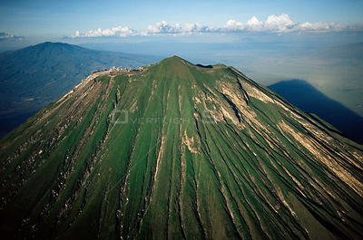 Aerial view of Ol Doinyo Lengai'(The Mountain of God) Volcano, Rift Valley, Tanzania. Note - light gray flows known as 'squee...