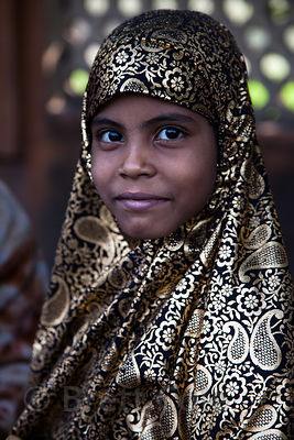 Portrait of a Muslim girl in a striking black and gold scarf, Esplanade, Kolkata, India.