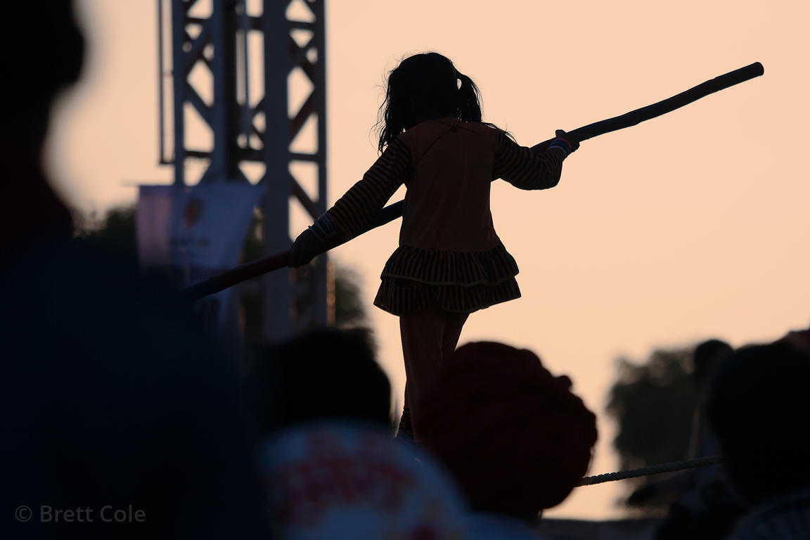 Girl performing a tightwire act at the 2010 Pushkar Camel Fair, Rajasthan, India