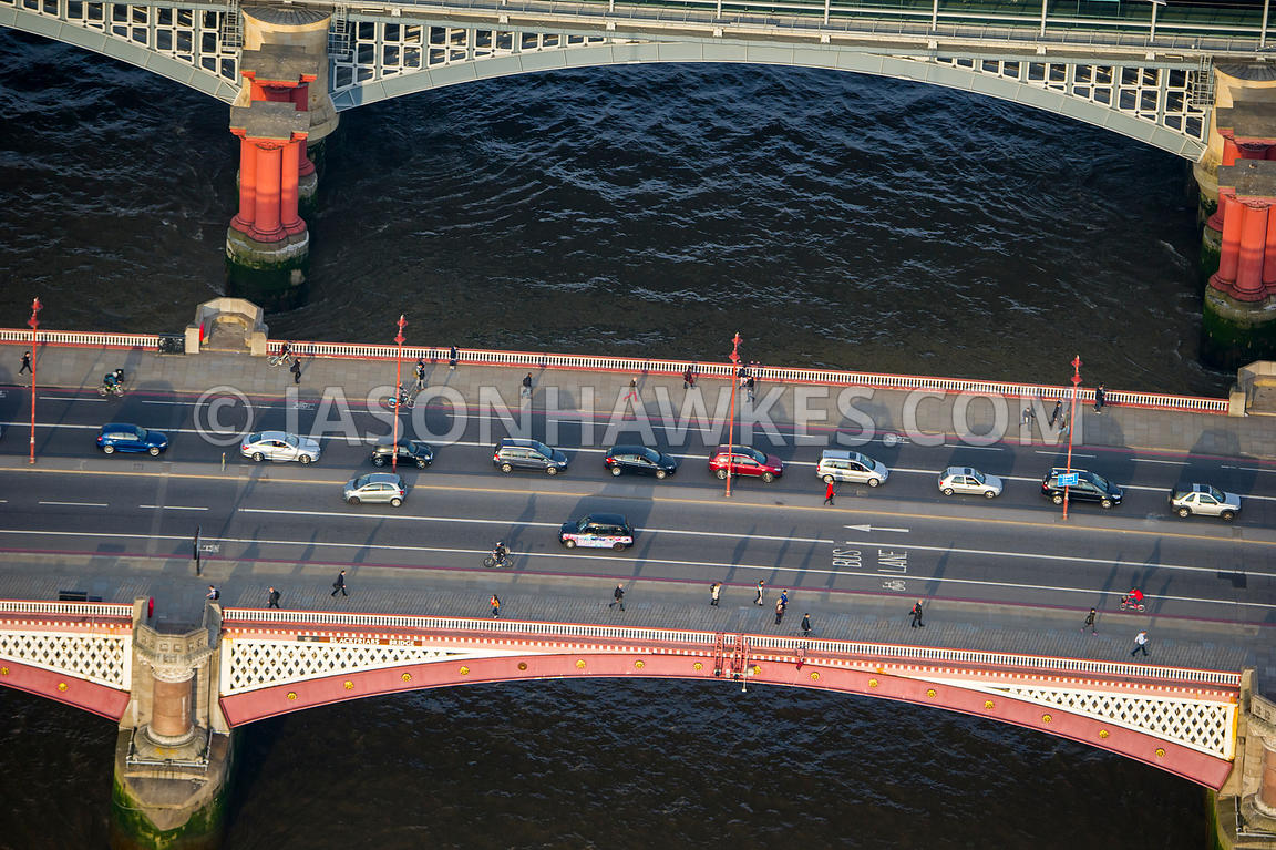 Aerial view of commuters crossing Blackfriars Bridge, London