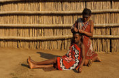 Swazi girls platting hair, Mantenga village, Swaziland