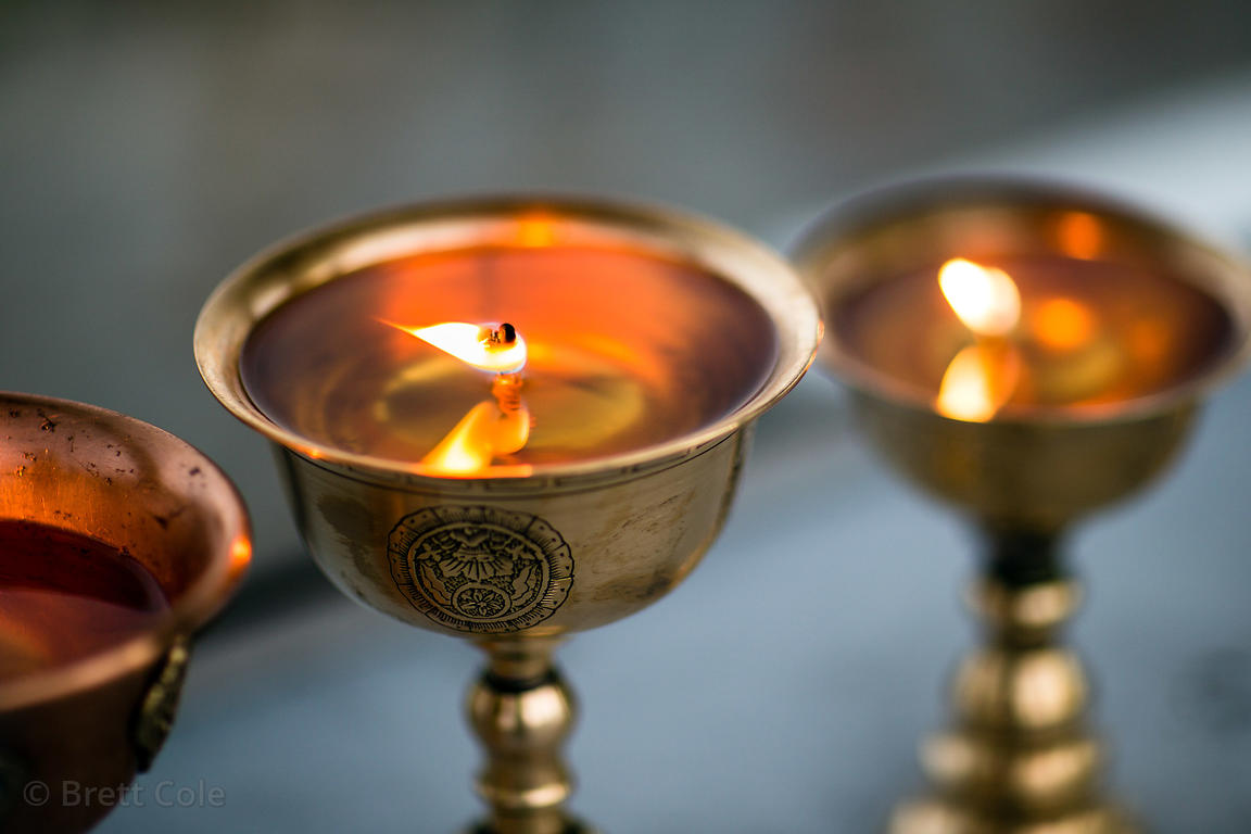 Brass oil lamps at the Shanti Stupa in Leh, Ladakh, India