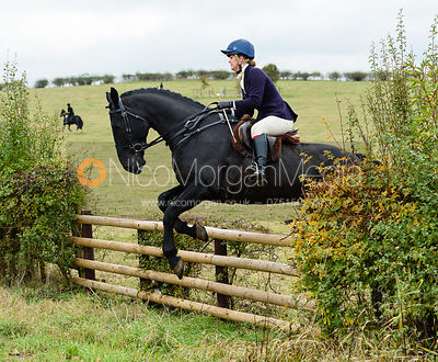 Sophie Judge jumping onto Bruce's Lane. The Cottesmore Hunt at Somerby