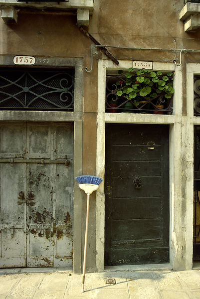 Italy - Venice - A broom propped up by a door