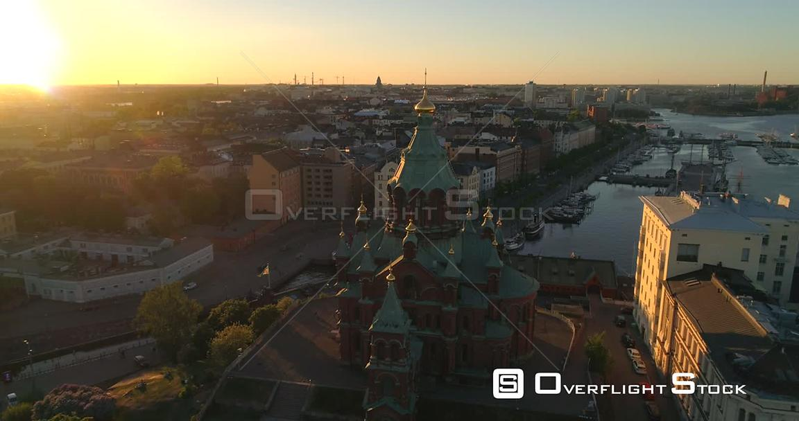 Helsinki Orthodox Church, Aerial Tilt View Away Uspetski Cathedral and Its Golden Cupole, in the City, on a Sunny Summer Even...