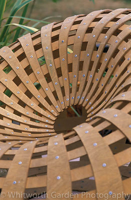 An oval shaped seat created from moulded plywood. © Rob Whitworth