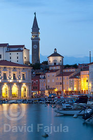 Piran's Tartini Square (Tartinijev trg) at dusk with the Church of Saint George (Cerkev sv. Jurija) on the background