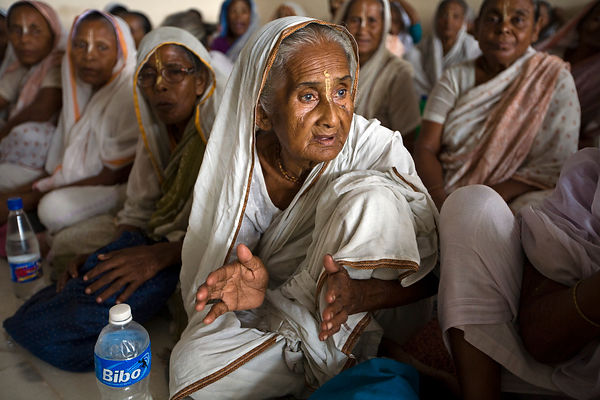 India - Vrindavan - Widows chant in an ashram for a meagre allowance of money