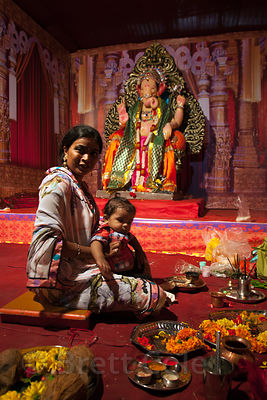 A family visits a Ganesh Pandal during the Ganesh Chaturthi festival in Lalbaug, Mumbai, India.
