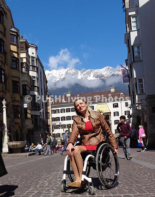 Woman tourist using a wheelchair in Innsbruck, Austria