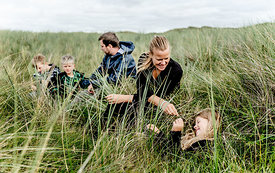 Danish family sitting in the dunes in Thy