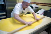 Italy - Bologna - a chef rolls out pasta