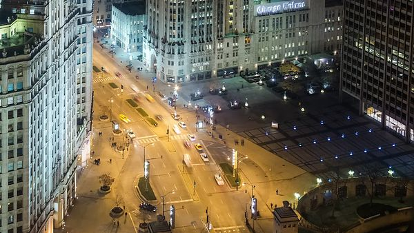 Bird's Eye: Close Up of A Pulsating Michigan Avenue Below the Historic Wrigley Clock Tower at Night