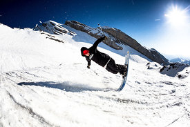 Adam Delorme is performing a nose butter 360 in La Clusaz Resort, France