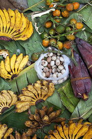 Bananas and coconuts for sale at a market in Shyambazar, Kolkata, India, during the Durga Puja festival. Bananas and coconuts...