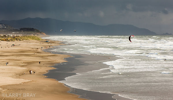 View along Ocean Beach with stormy skies in the distance in San Francisco, USA