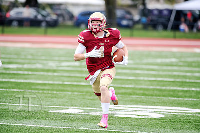 Coe College's Tyler Schamel (4) runs for a touchdown against Central during the first half of play at Clark Field in Cedar Ra...