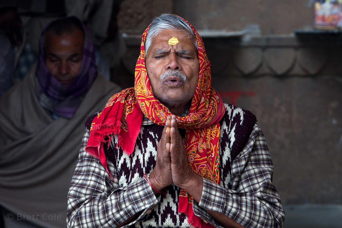 A man prays along the Ganges River, Varanasi, India.