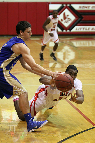 Iowa City High's Tony Perry (34) goes for the ball against Wahlert's Jake May (21) in the second half Tuesday night. Dubuque ...