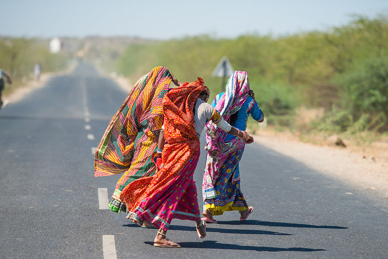 A group of women trying to cross a road
