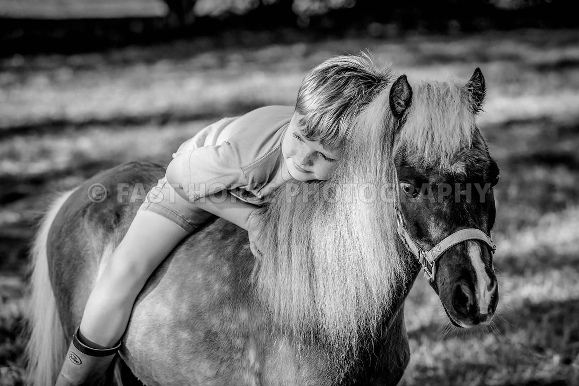 Fast Horse Photography A Young Boy Enjoys Time With His Miniature Horse In The City Of St Augustine Florida
