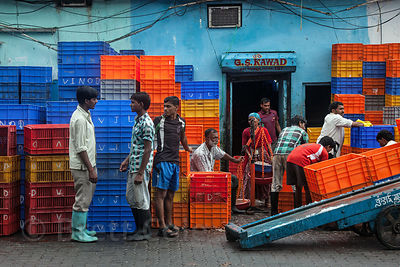 Colorful crates at a fish processing facility at Sassoon Docks, Mumbai, India.