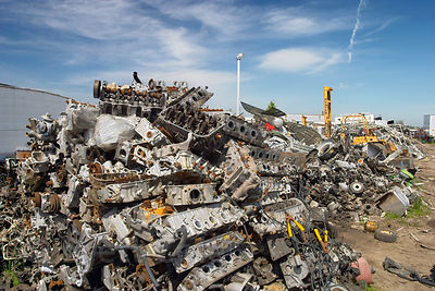 Wide view of engine blocks sitting in a junkyard, Springfield, Oregon